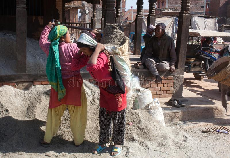 Nepalese women working hard in road-building stock images