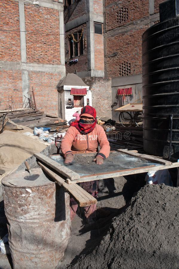 Nepalese women working hard in road-building after the earthquake in Kathmandu. PATAN, NEPAL - JANUARY 22, 2017: Nepalese women working hard in road-building stock photo