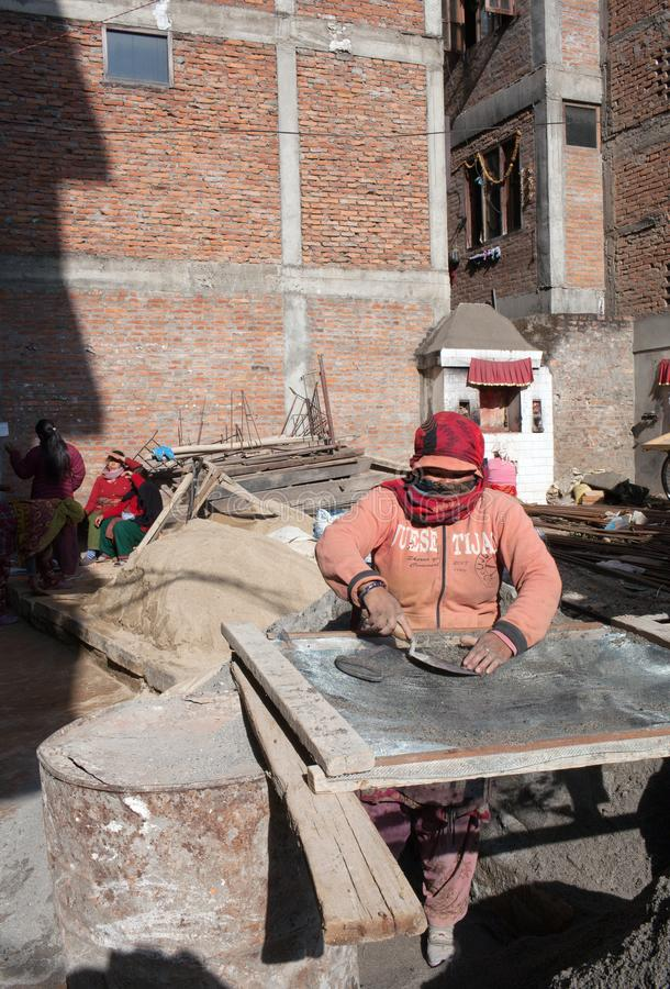 Nepalese women working hard in building after the earthquake in Kathmandu. PATAN, NEPAL - JANUARY 22, 2017: Nepalese women working hard in road-building after royalty free stock photos