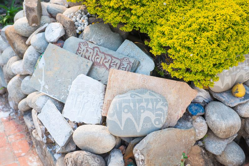 Nepalese word of psalms on stone in temple. Kathmandu royalty free stock image