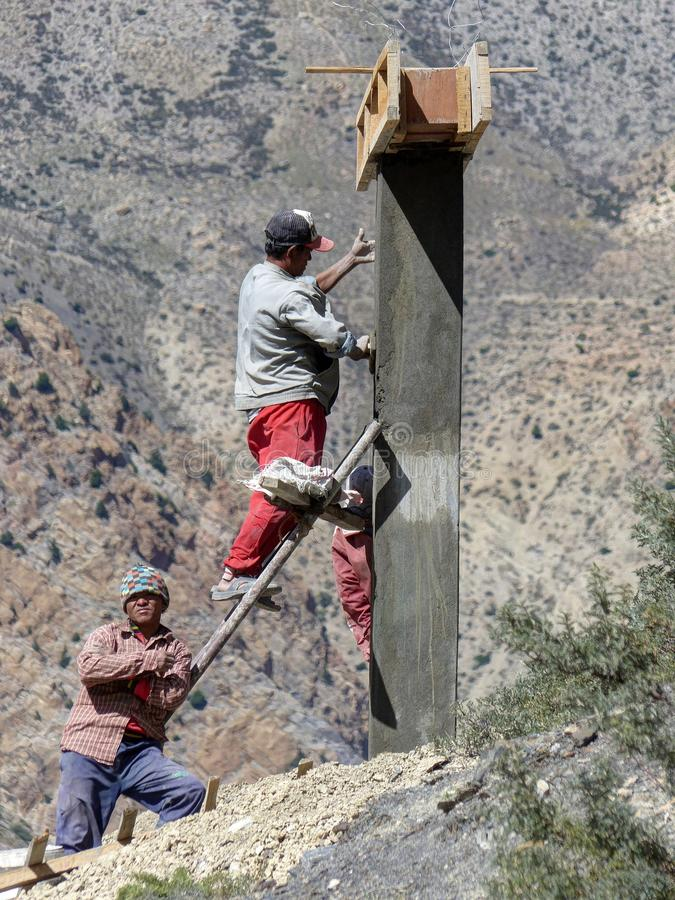 Nepalese workers. Nepalese men are building entrance gate stock images