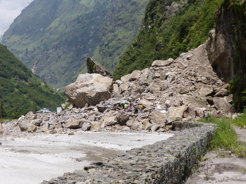 Nepalese workers rebuilding road stock photography