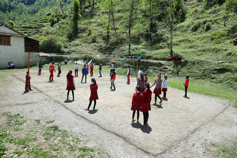 Nepalese young kids playing volleyball stock photography