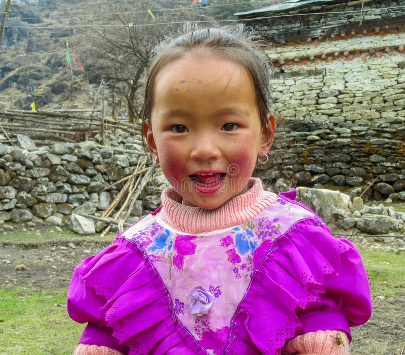 Nepali little girl living in a village smile royalty free stock image