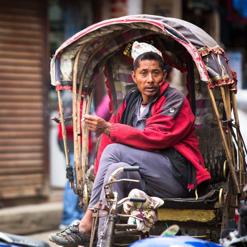 Nepali rickshaw in historic center of city. Largest city of Nepal, its historic center, a population of over 1 million people. KATHMANDU, NEPAL - NOV 28, 2013 royalty free stock photography