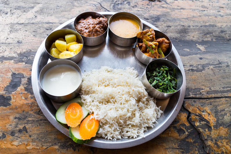 Nepali Thali meal set with curry mutton royalty free stock photography