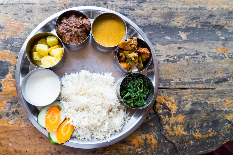 Nepali Thali meal set with curry mutton royalty free stock images