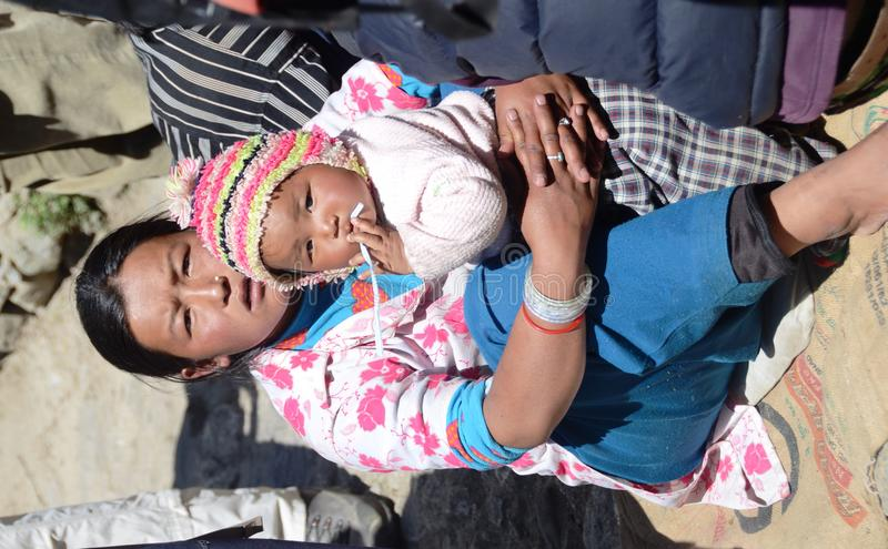 Download Nepali woman and her baby editorial photography. Image of older - 22145467