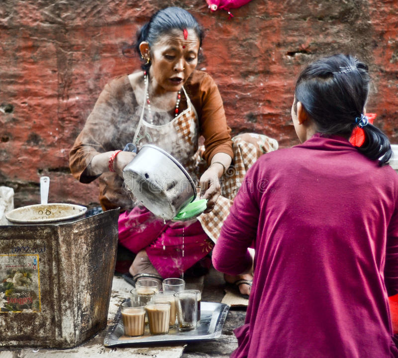 Nepali woman selling local drinks royalty free stock photos