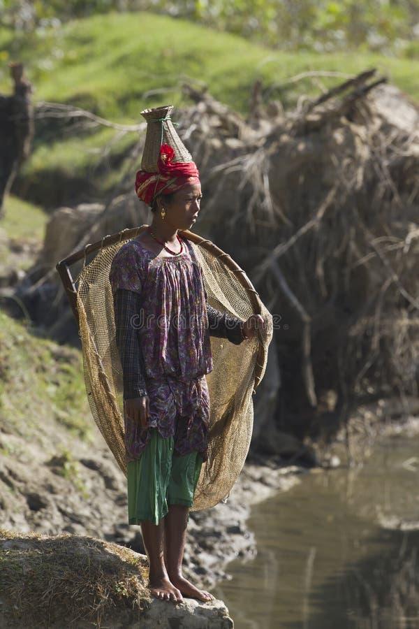 Nepalski Taru kobiety połów z siecią fotografia stock