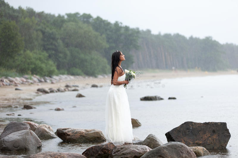 Neptun's bride. Bride is waiting for groom under the rain stock photos