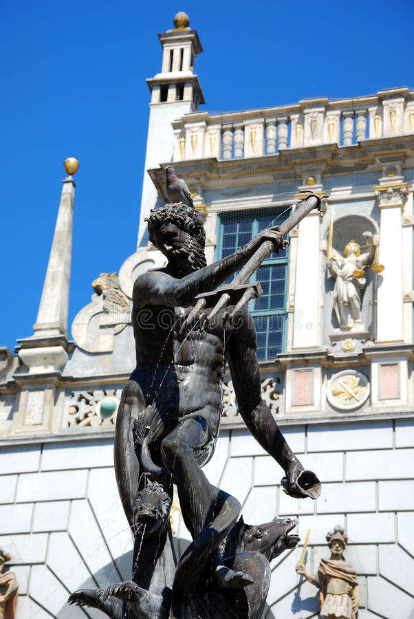 Neptune fountain with pigeon on the head in Gdansk stock image