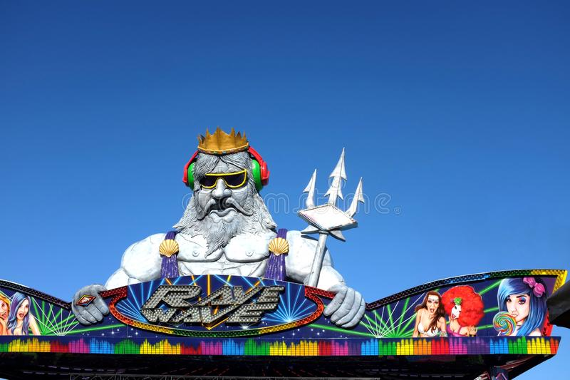 Neptune with his trident atop the Rave Wave Ride at the Orange County  Fair. COSTA MESA, CALIFORNIA - AUG 8, 2019: Neptune with his trident atop the Rave Wave stock photo