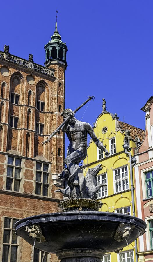 Neptune`s Fountain in front of vintage architecture of Old Town - Long Market, Gdansk, Tricity, Poland royalty free stock photography