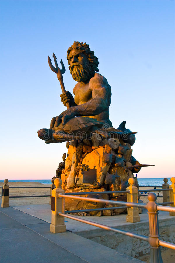 Neptune at VA Beach. Bronze King Neptune statue at sunset at Virginia Beach. Photographed in February during the off-season
