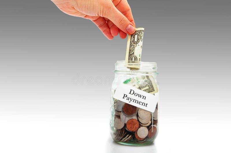 Ner - betalningpengar arkivbilder