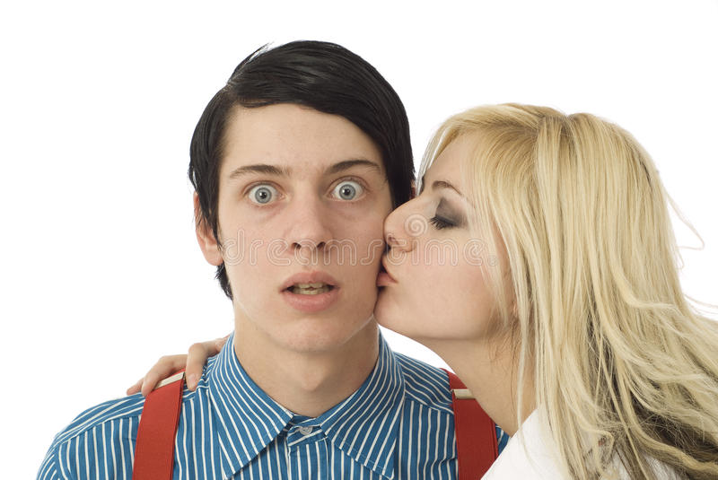 Nerd boy surprised by pretty girl stock photography