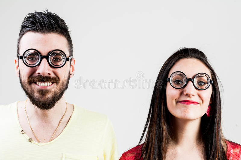 Nerd couple made by a nerd man and nerd woman royalty free stock image
