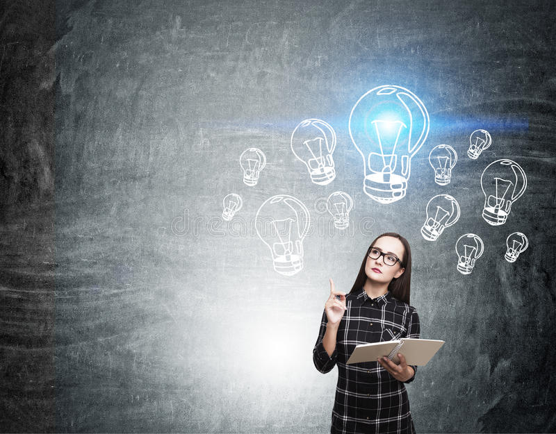 Nerd girl and blue light bulb sketches stock photography