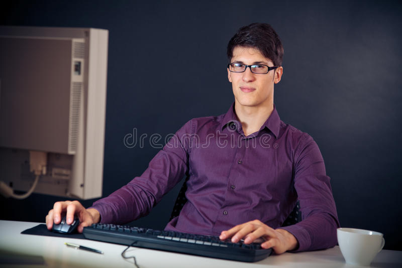 Nerd And His Computer stock photos