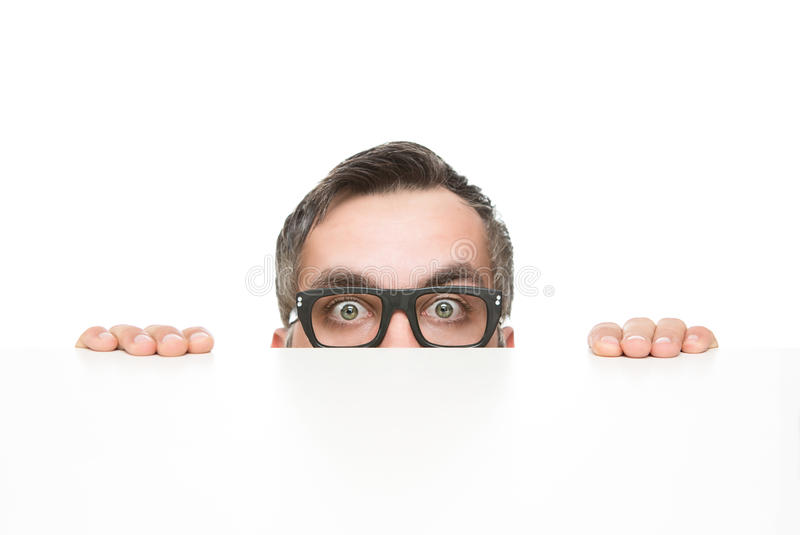 Nerd peeking stock photo