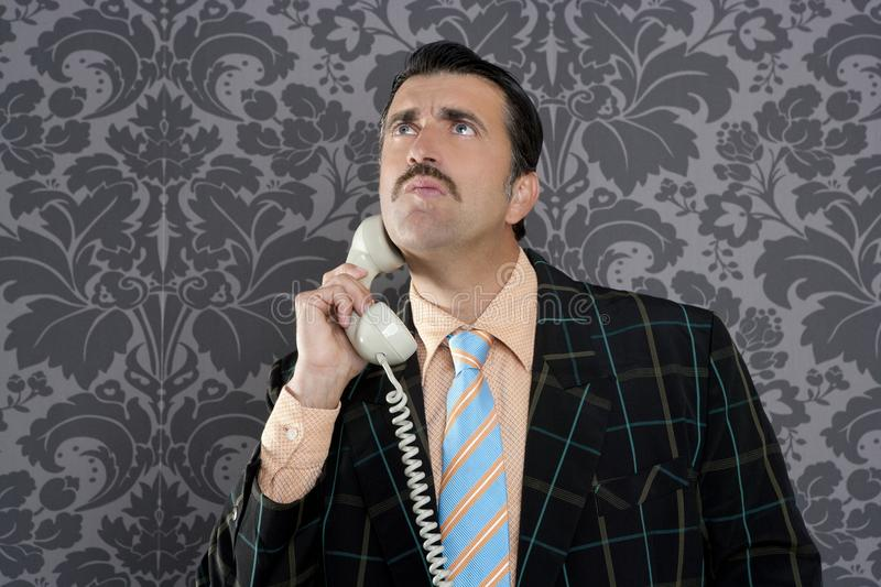 Nerd scared expression businessman telephone call. Mustache retro stock photo