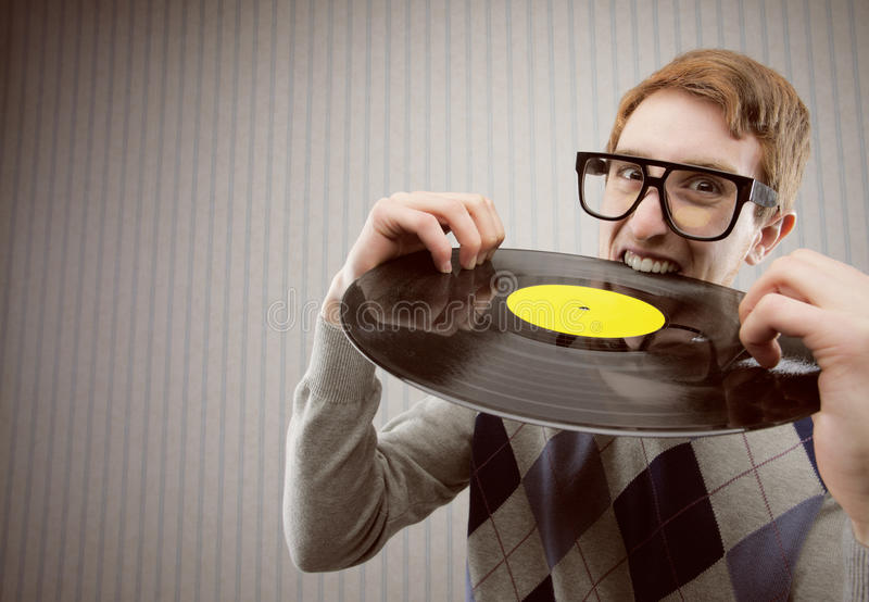Student angry, biting a vinyl record stock photos