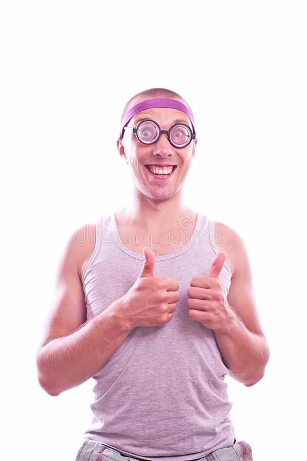 Nerd with thumbs up. Portrait of a nerd in eyeglasses with thumbs up royalty free stock image