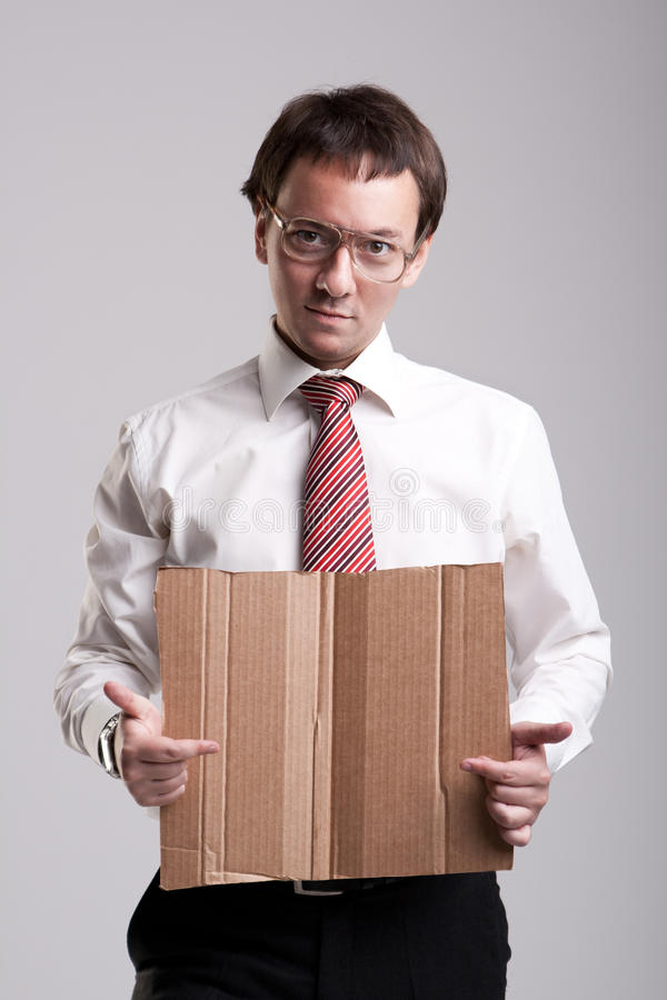 Nerdy businessman. Holding a cardboard royalty free stock photo