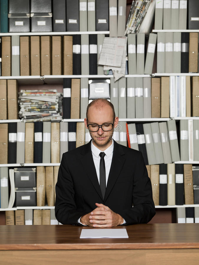 Nerdy Businessman. At the office stock images