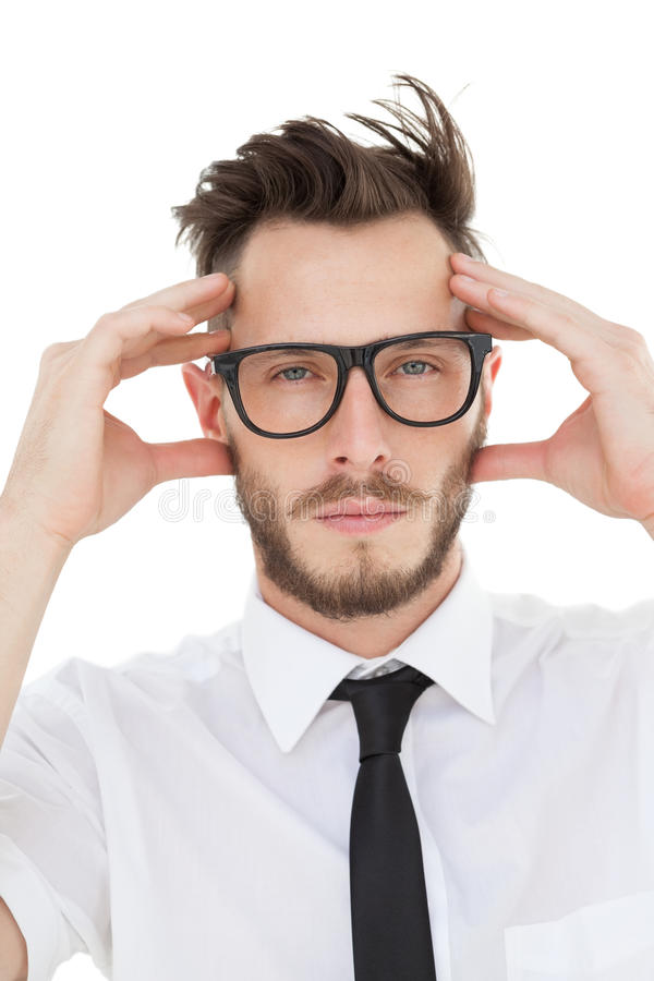 Nerdy businessman getting a headache. On white background stock photos