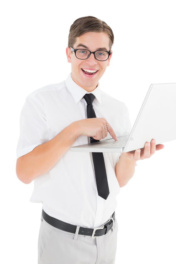 Nerdy businessman holding his laptop. On white background stock photography