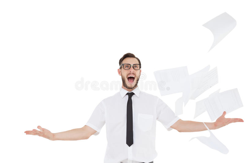 Nerdy businessman with papers flying. On white background stock image