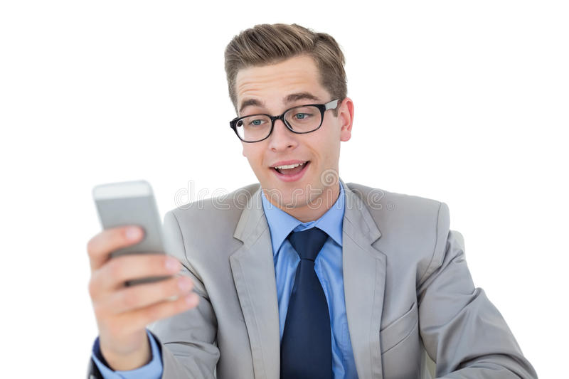 Nerdy businessman sending a text. On white background royalty free stock photography
