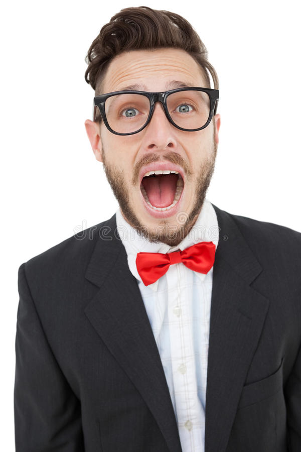 Nerdy businessman shouting with mouth open. On white background royalty free stock image