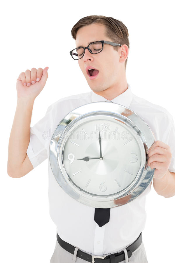 Nerdy businessman showing clock to camera. On white background stock images