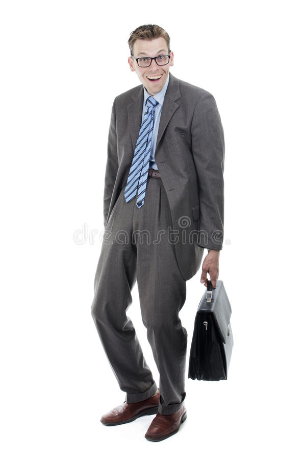 Nerdy businessman with suitcase. Acting goofy royalty free stock photos
