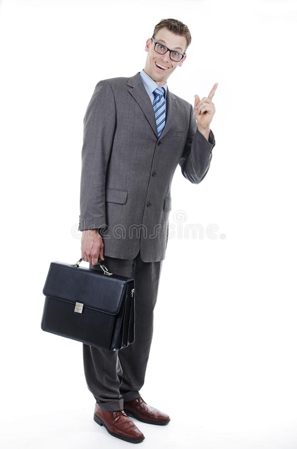 Nerdy businessman with suitcase. Making a point stock photo