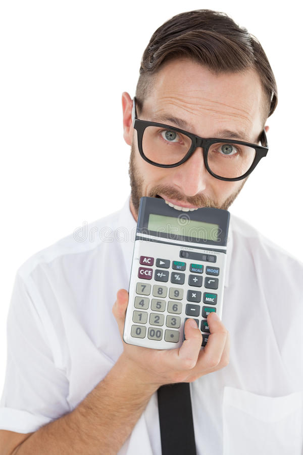 Nerdy excited businessman biting calculator. On white background royalty free stock image