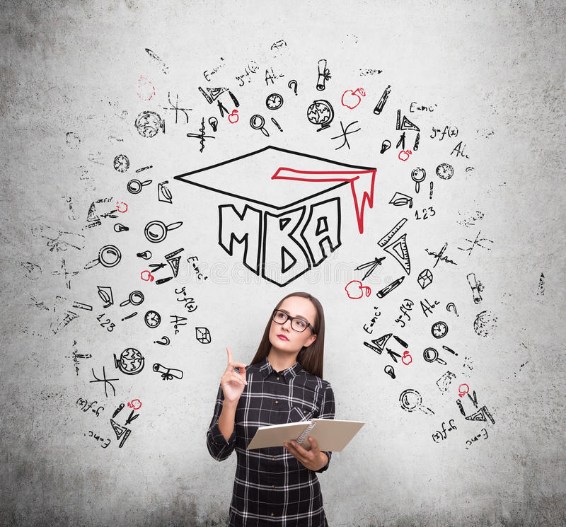 Nerdy girl and an mba sketch on concrete stock image