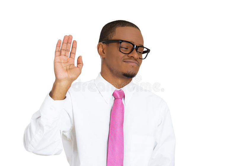 Nerdy guy with bad attitude. Closeup portrait young, nerd grumpy man, glasses, with bad attitude giving talk to hand sign with palm outward, isolated white stock photos