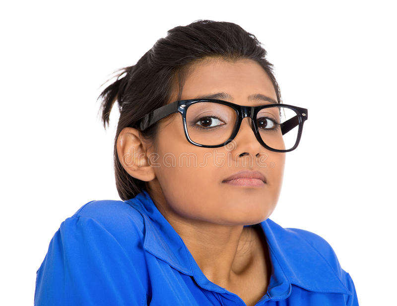 Nerdy woman. Closeup portrait of a young nerdy looking woman with big glasses, very timid suspicious shy and anxious looking at you, isolated on white background stock image