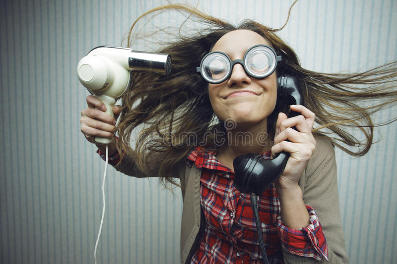 Nerdy woman drying hair stock image
