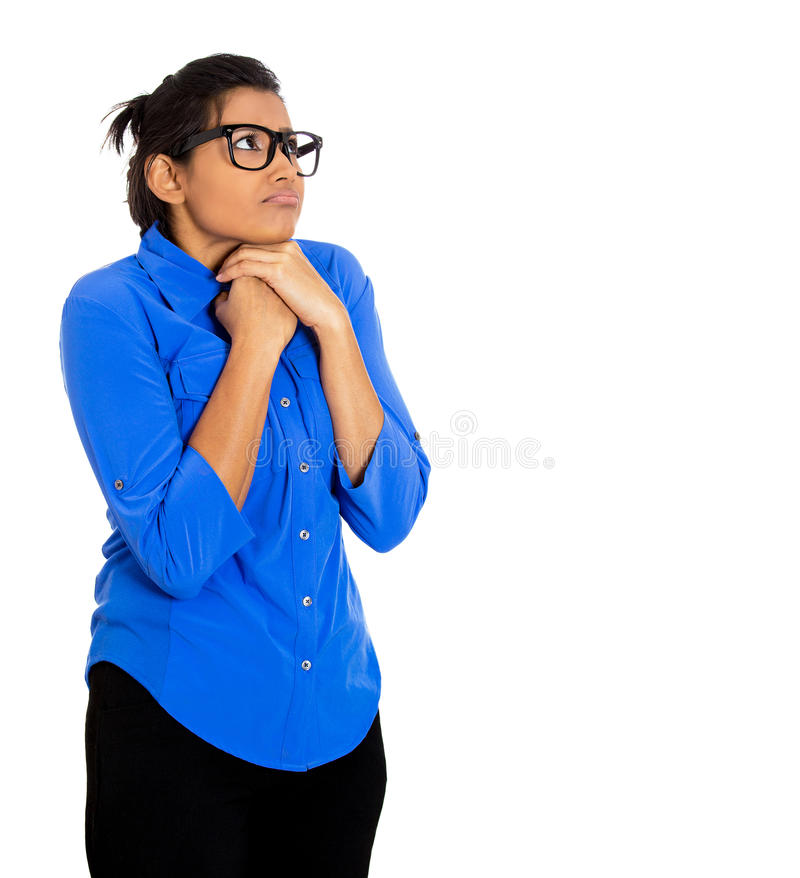 Nerdy woman with glasses. Closeup portrait of a young nerdy looking woman with big glasses, very timid suspicious shy and anxious looking away up isolated on stock photography