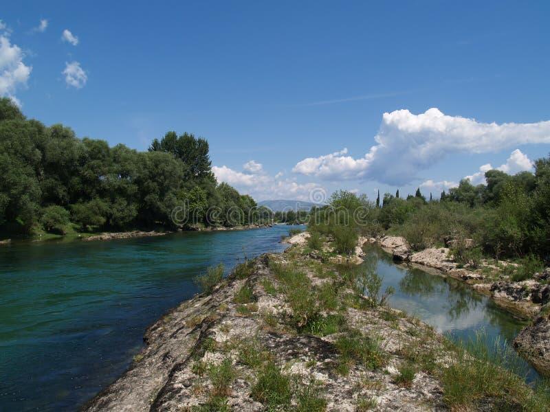 Neretva river. Scenic view of Neretva river under blue sky and cloudscape, Adriatic basin, Bosnia and Herzegovina and Croatia stock photography