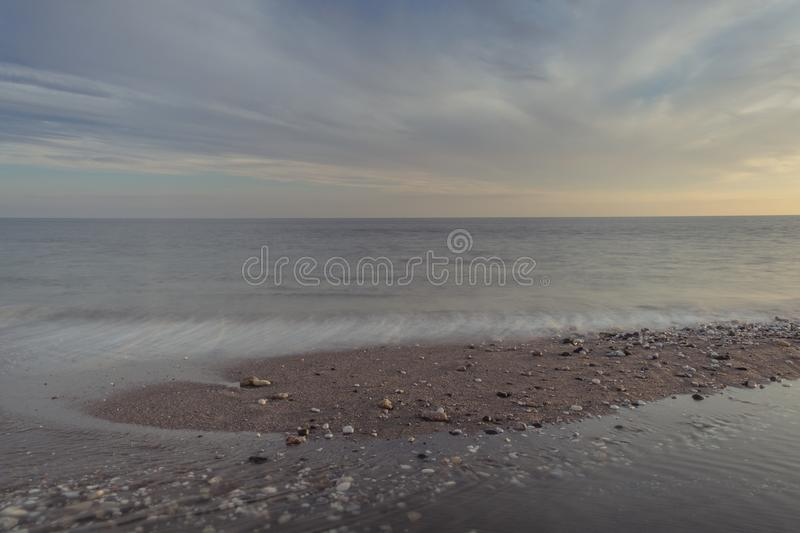 Long exposure on the beach. Nerja, Malaga, Andalusi, Spain - November 29, 2018: Long exposure of the sunset on the beach in village of Nerja, Spain stock photography