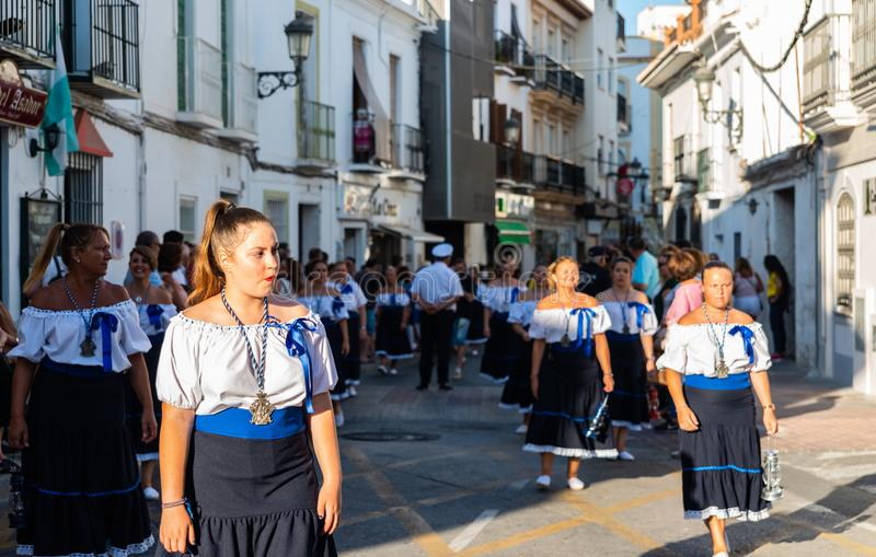 NERJA, SPAIN - JULY 16, 2018 annual parade in the coastal Andalusian town on the occasion of a pilgrimage with the sculpture stock photo