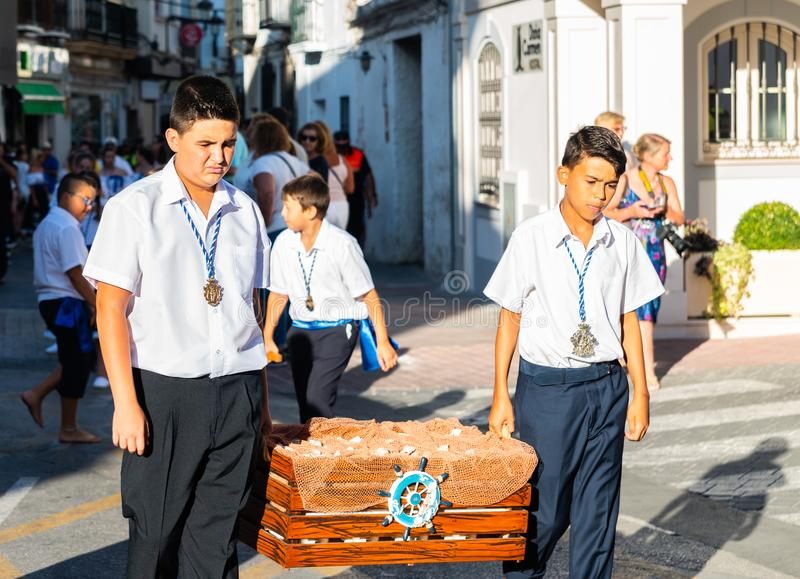 NERJA, SPAIN - JULY 16, 2018 annual parade in the coastal Andalusian town on the occasion of a pilgrimage with the sculpture stock image