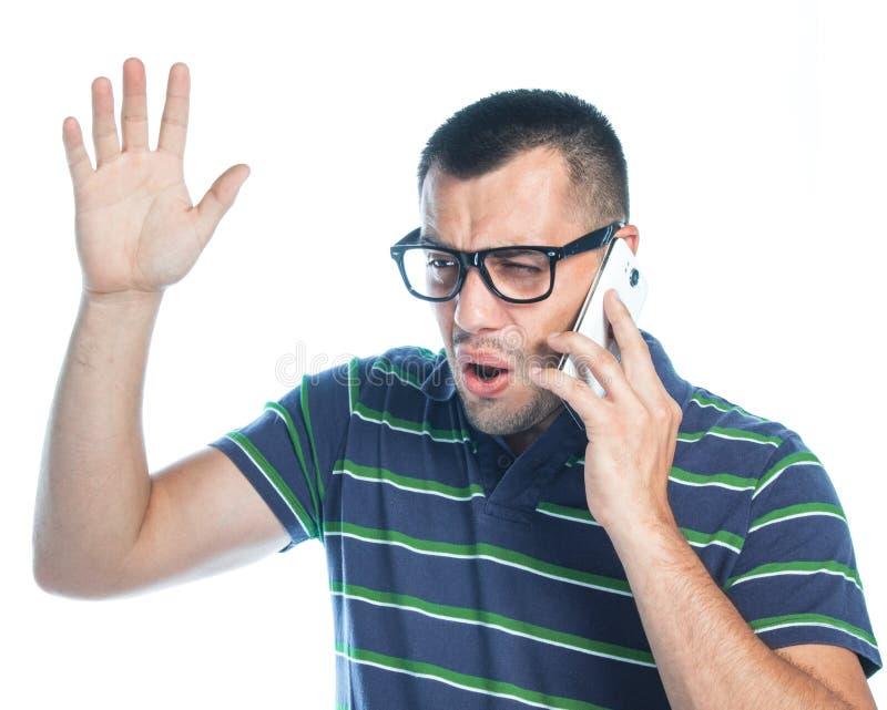 Nervös man på telefonen fotografering för bildbyråer