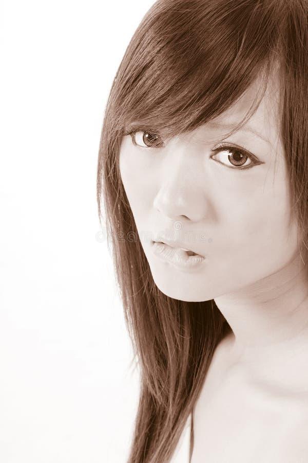 nervös tonåring för asiatisk flicka arkivfoto